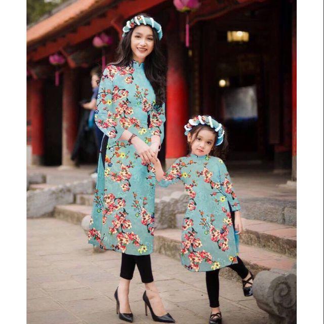 Sét áo dài cách tân gấm hoa + chân vấy mẹ bé .. ..