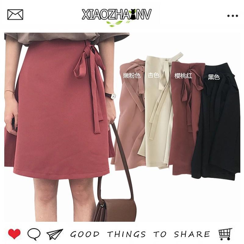 Chân váy nữ lưng cao có nơ cỡ lớn