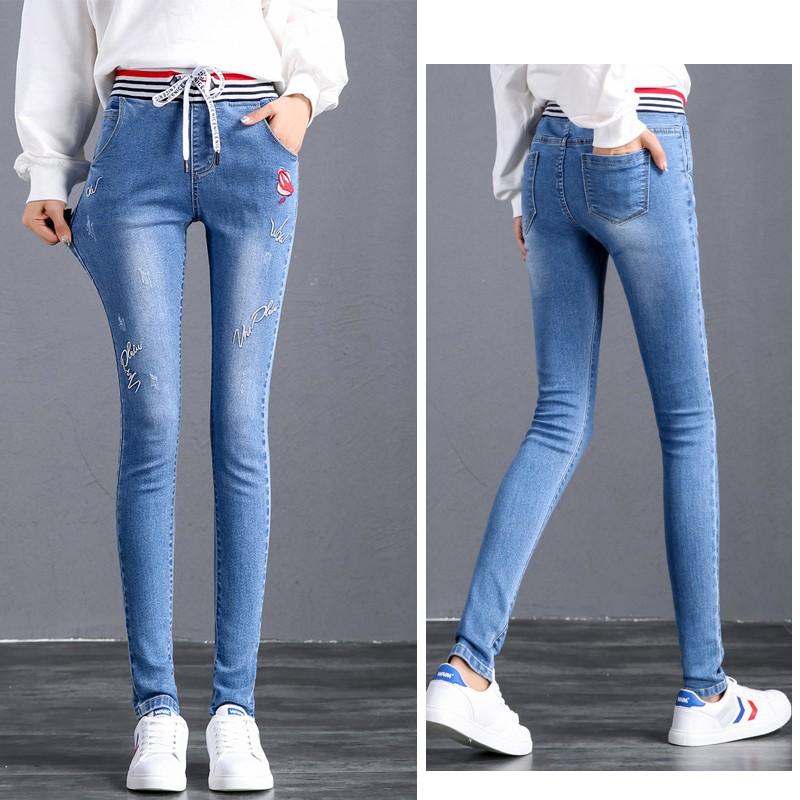 Quần jeans lưng cao dây rút co giãn thêu họa tiết cho nữ