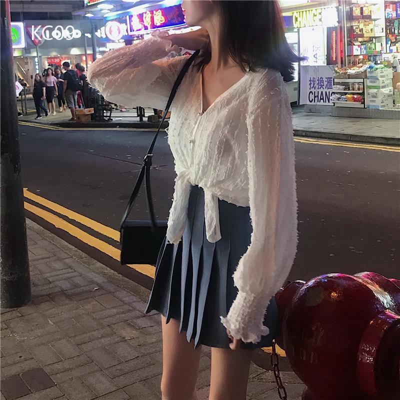Set áo tay dài kèm chân váy ngắn xếp li thời trang Hàn Quốc cho nữ