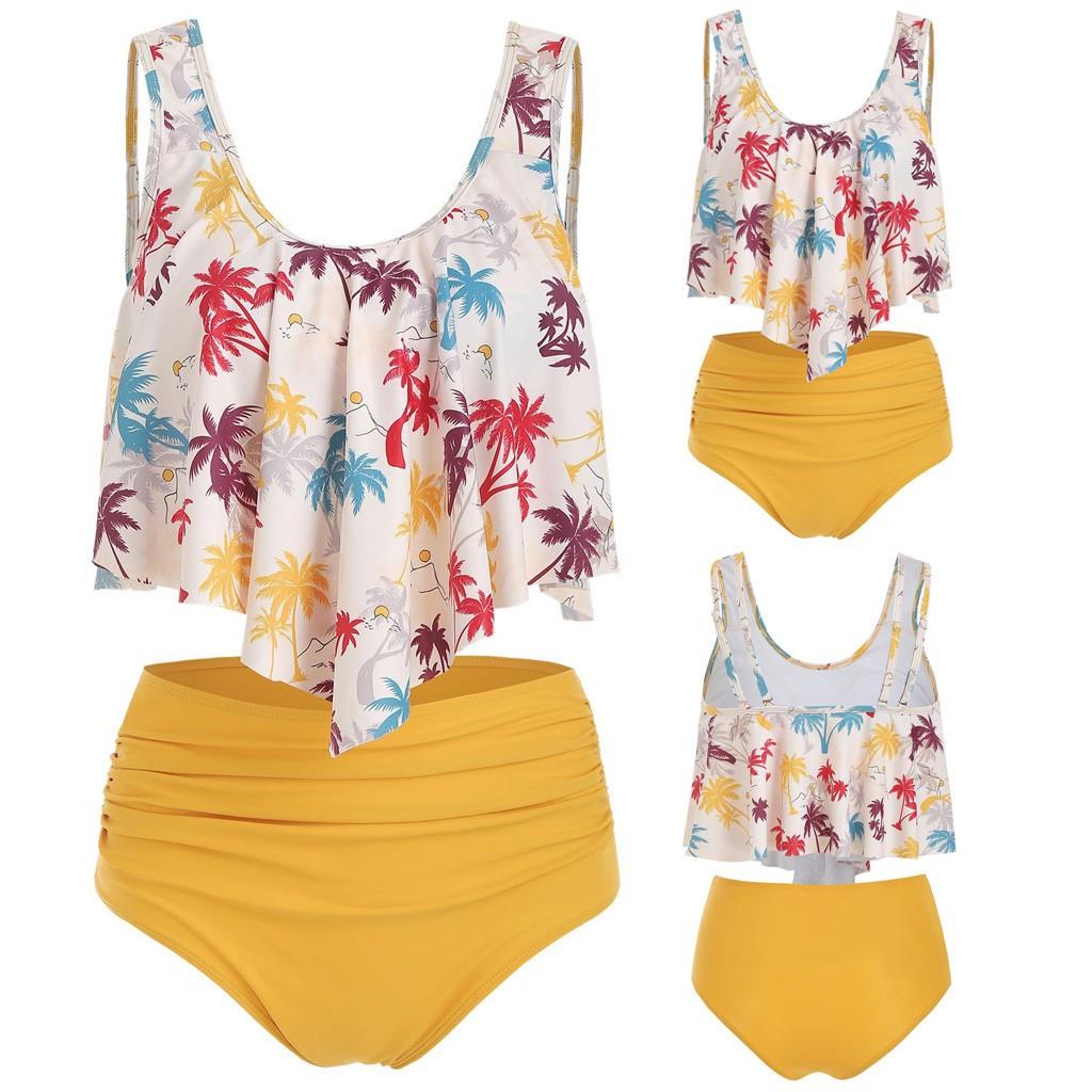 Bikini liền thân với áo hai dây in họa tiết cây dừa sặc sỡ và quần lót lưng cao phong cách quyến rũ dành cho nữ
