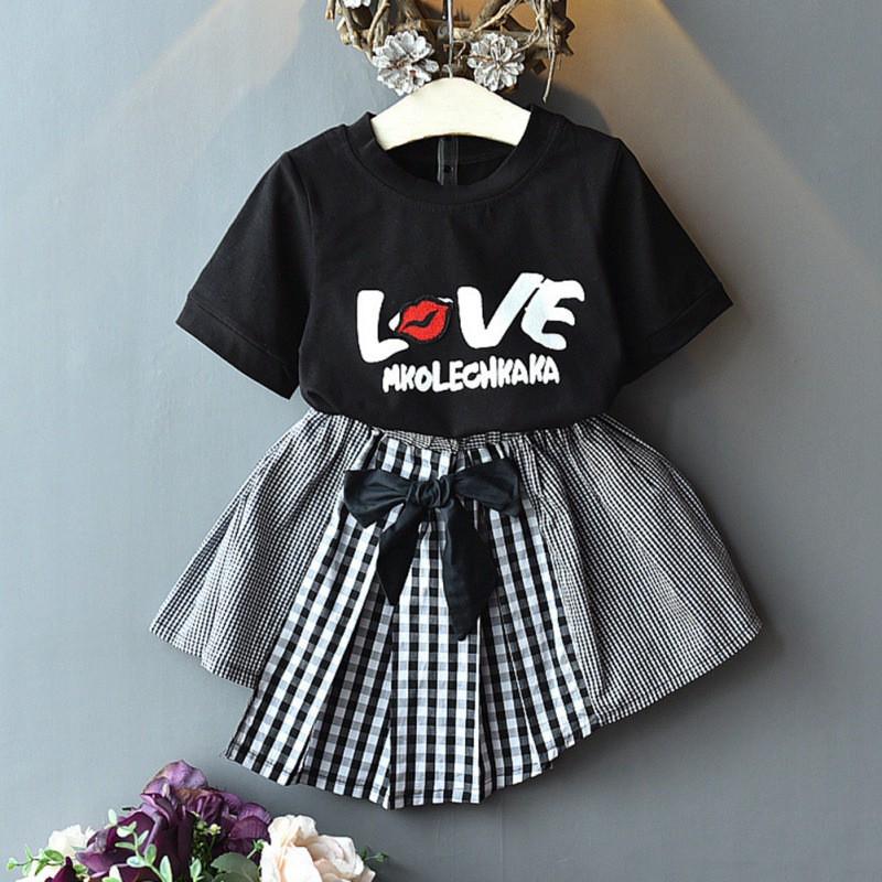 Bộ áo thun in chữ + Chân váy nơ cho bé gái