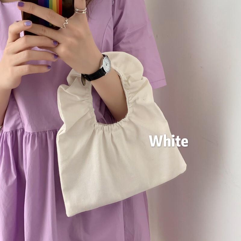 Túi xách cầm tay phong cách Hàn Quốc