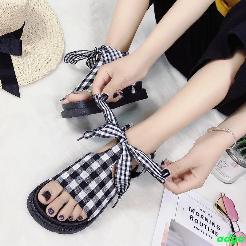 Sandals female 2019 new summer students wild flat bottom fairy wind thick bottom word with net red ins beach shoes tide