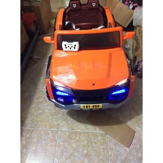 Ô tô điện trẻ em cao cấp KIỂU DÁNG ĐỊA HÌNH CỠ LỚN Model BY-666, 2 chỗ ngồi, 4 động cơ, bảo hành 6 tháng phần ắc qui+sạc