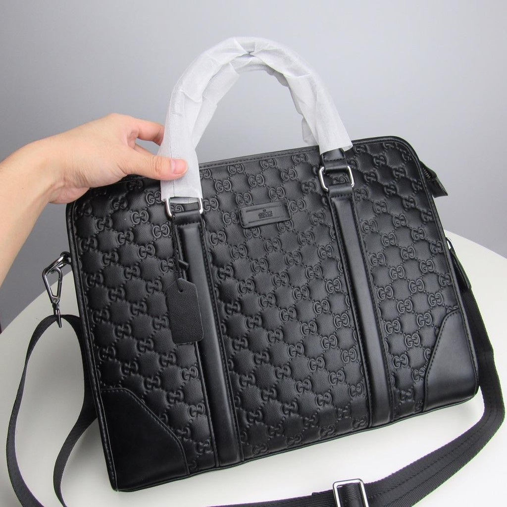GUCCI Gucci กระเป๋าแฟชั่นของ Messenger กระเป๋าสะพายกระเป๋าด้านข้างกระเป๋าเป้สะพายหลัง GUCCI ผู้ชายกระเป๋าเอกสารธุรกิจ
