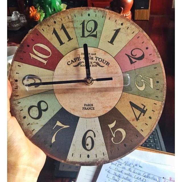 Đồng hồ treo tường kim trôi