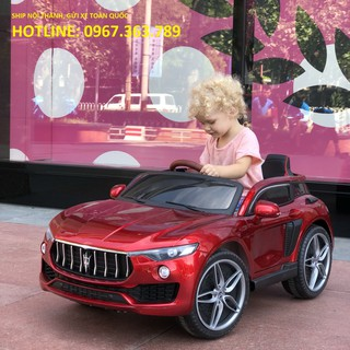 Ô tô xe điện đồ chơi vận động cho bé KUPAI 2021 (Đỏ-Trắng-Cam)