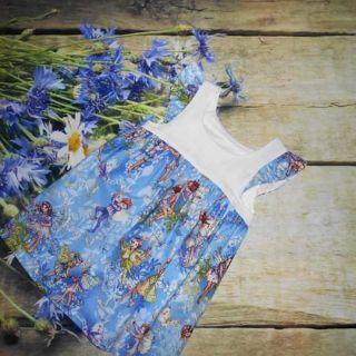 Váy bé gái họa tiết tiên xanh