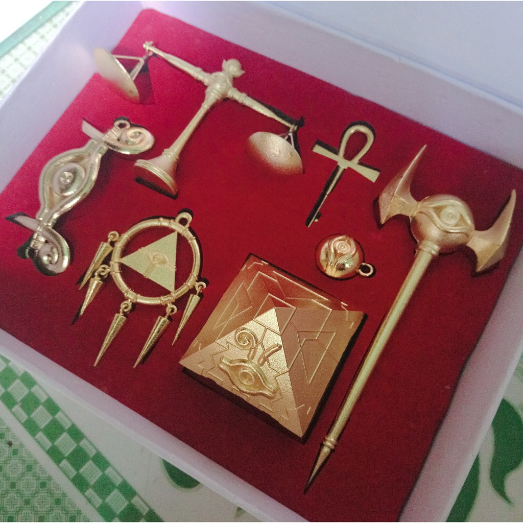 Bộ 7 báu vật ngàn năm Yugioh bằng kim loại ( trang trí, dây chuyền, móc khoá )
