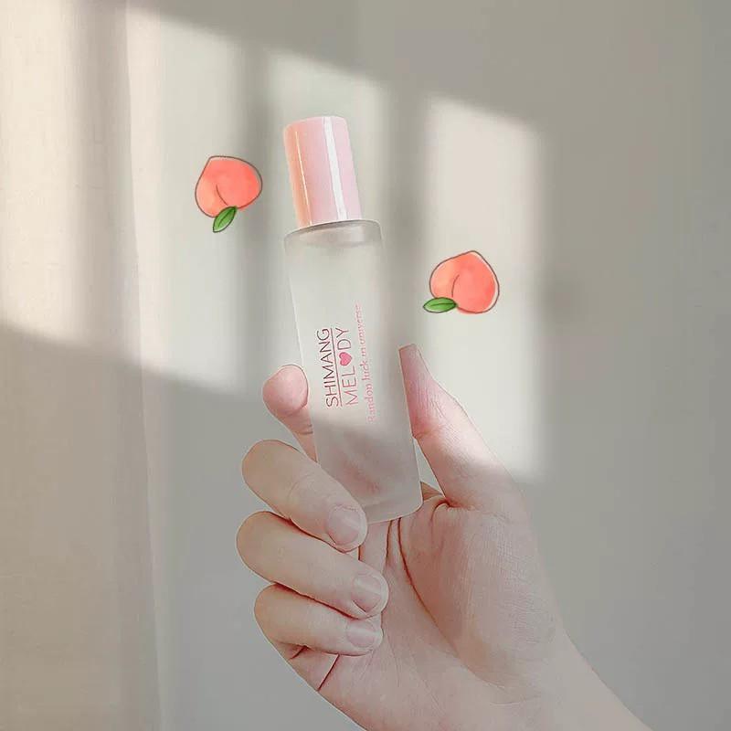 Nước hoa body với hương đào mix hương hoa Melody Randon Luck In Universe Shimang