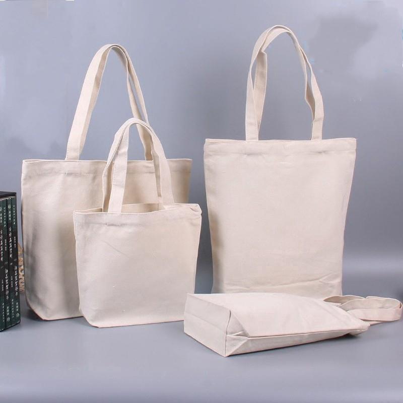 Túi tote bằng chất liệu cotton canvas màu trắng kem đơn giản dùng khi đi mua sắm