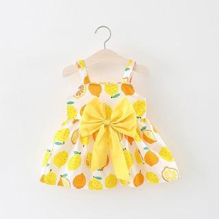 Đầm xòe in hình trái dây đính nơ dễ thương cho bé
