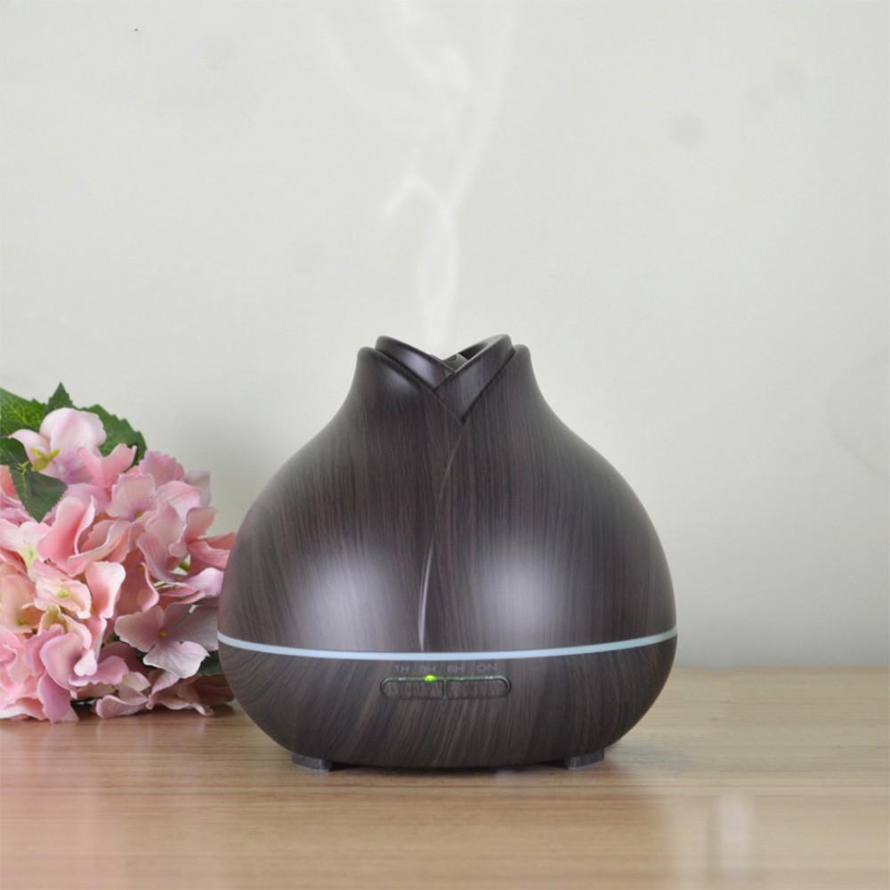 Máy xông tinh dầu phun sương hình nụ hoa 550ml tích hợp điều khiển và 2 chai tinh dầu 10ml