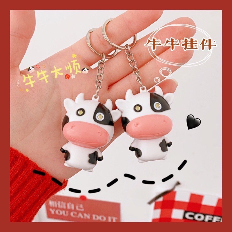Móc khóa hình bò sữa mắt phát sáng và phát tiếng kêu dễ thương cho xe máy, oto, hộp bút, balo, ví