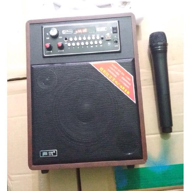 Loa Bluetooth A062 bọc gỗ tặng kèm micro không dây