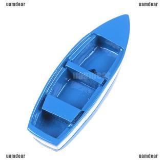 Mô hình chiếc thuyền mini bằng nhựa màu xanh dùng trang trí cho bé