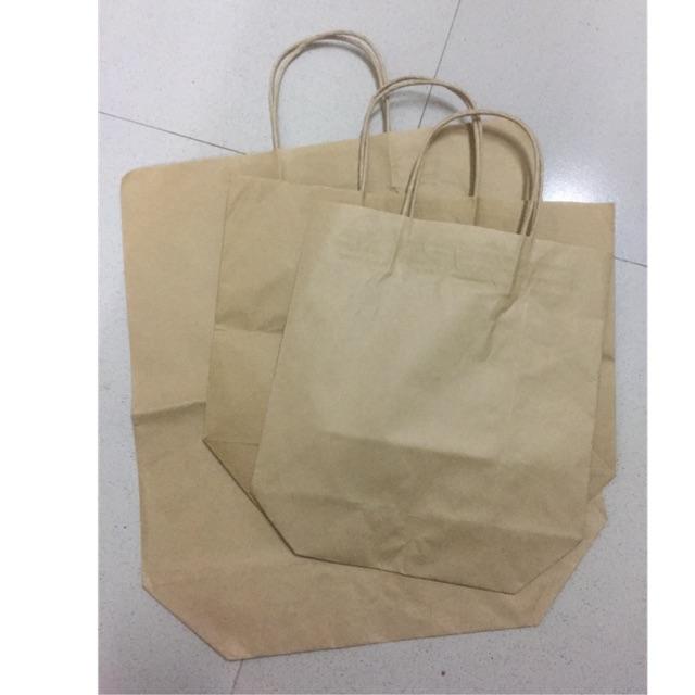 50 Túi giấy xi măng có quai loại quai giấy kt lớn