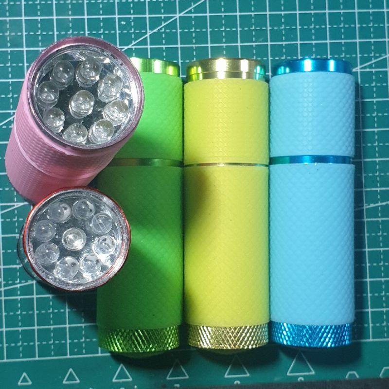 Đèn pin uv 9 bóng vỏ bọc silicon