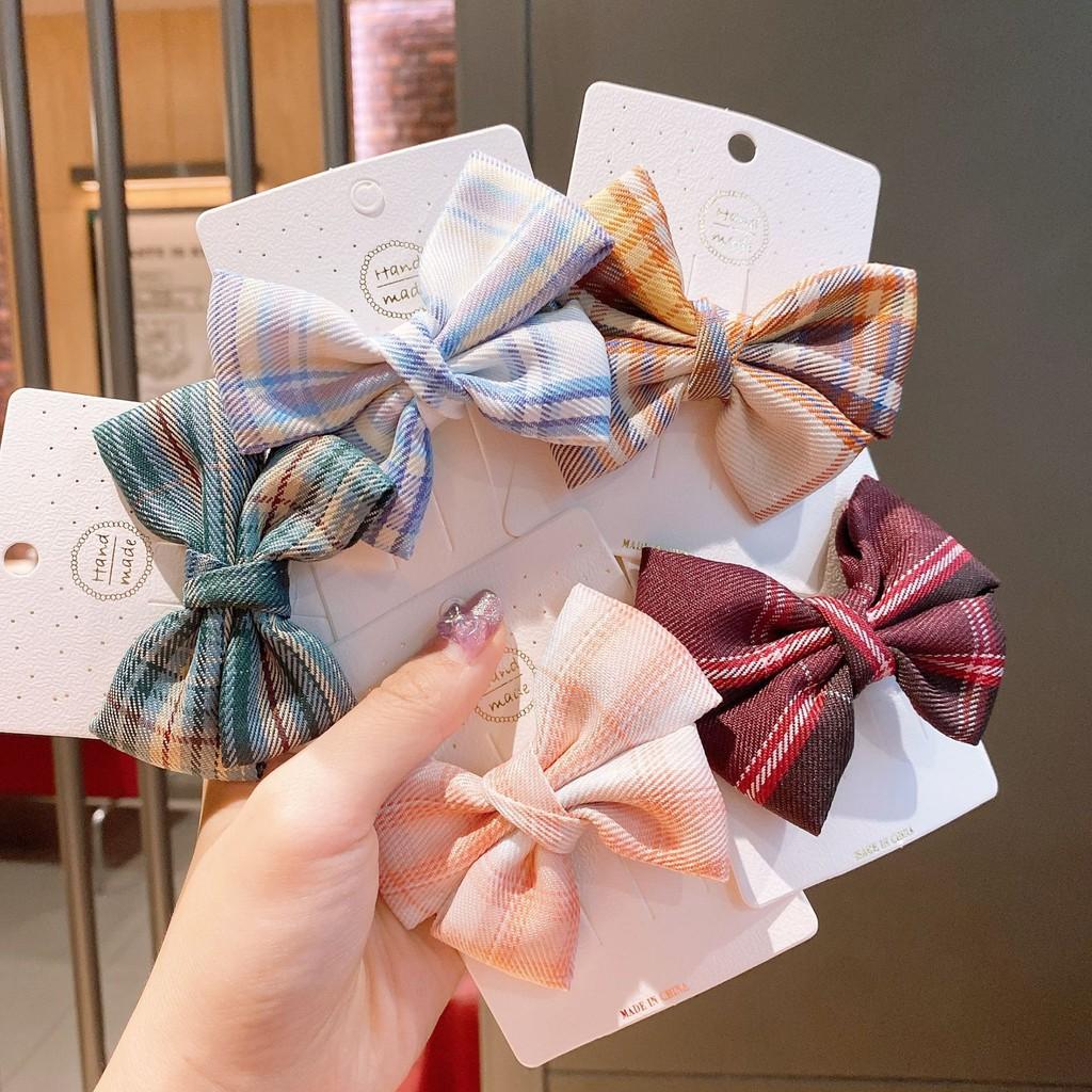 Kẹp tóc đính nơ vải in caro thời trang Hàn Quốc cho bé gái