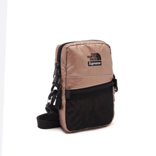 Túi đeo chéo Supreme North Face Metalic shoulder bag
