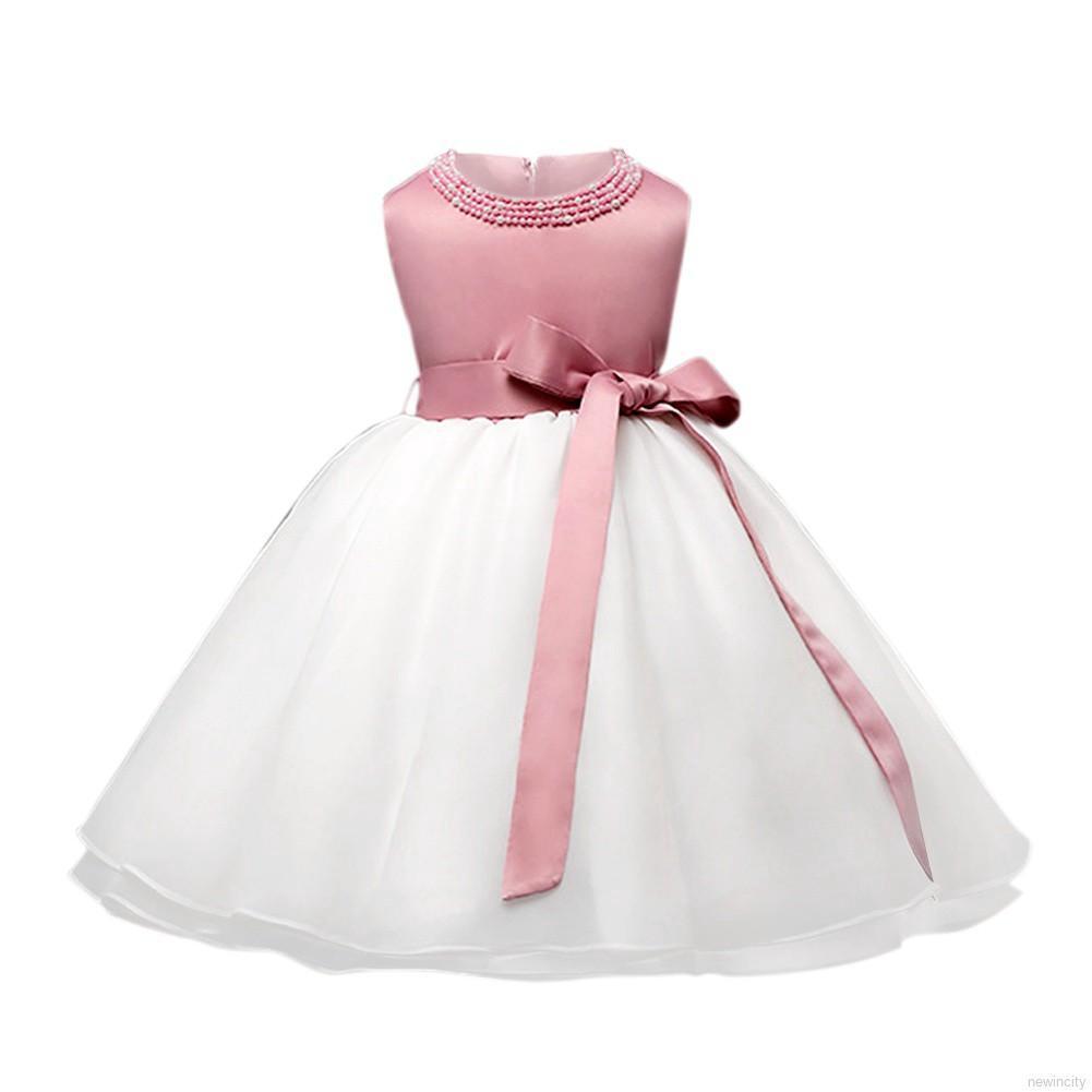 Đầm dự tiệc cưới có đính ngọc trai cho bé gái