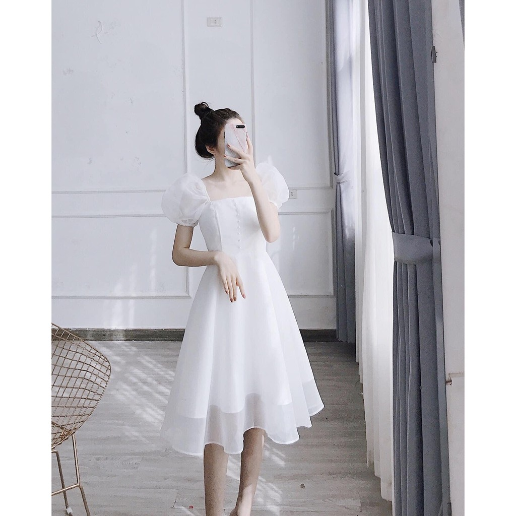 Đầm xòe tay phồng phối nút ngực chất tơ xinh cực Daria