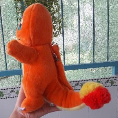 Gấu bông có túi khóa kéo hình khủng long