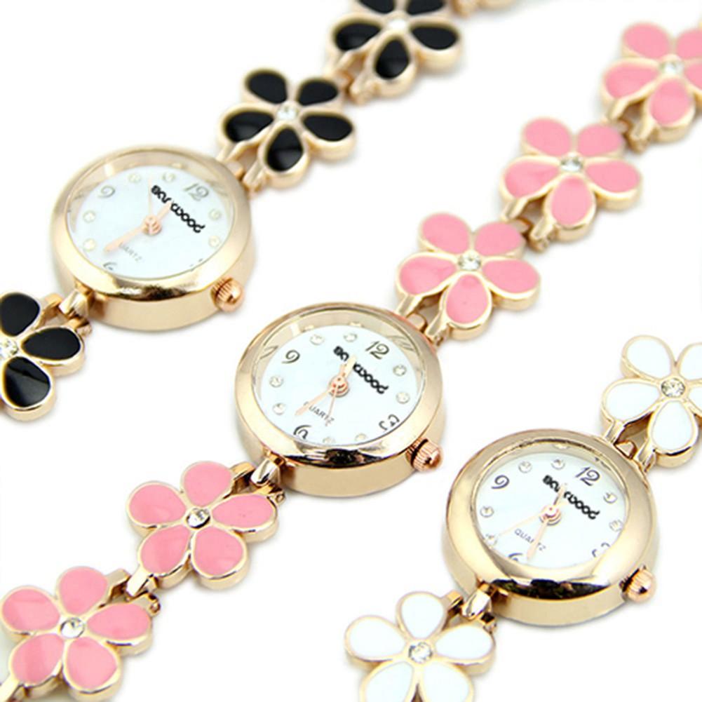 Đồng hồ mặt tròn dây đeo hình hoa cúc mạ vàng Hàn Quốc cho nữ