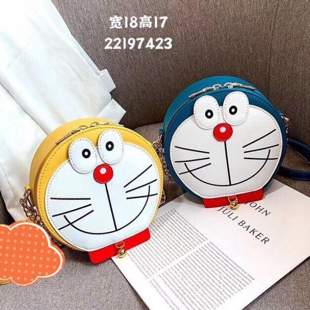 Túi đeo mặt mèo đô rê mon