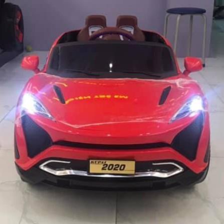 Ô tô xe điện đồ chơi KUPAI 2020 cao cấp 4 động cơ 12V7AH cho bé vận động ngoài trời (Đỏ-Cam-Trắng)