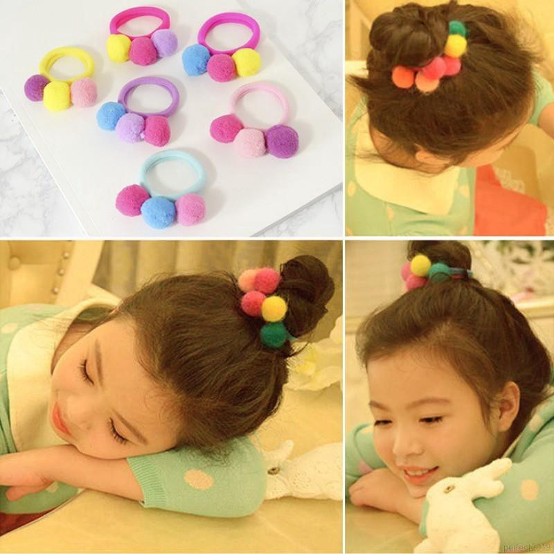 Thun cột tóc có chi tiết quả bóng lông dễ thương cho bé gái