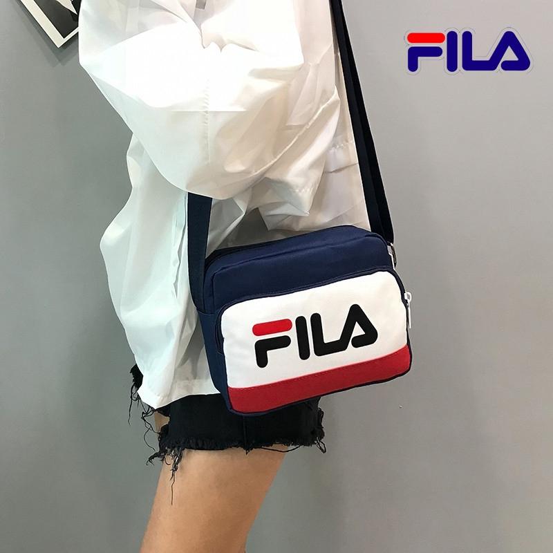 FILA อินซูเปอร์ไฟกระเป๋าผ้าใบใหม่ถนนแฟชั่นสตรีทแฟชั่นป่าไหล่กระเป๋าสะพาย