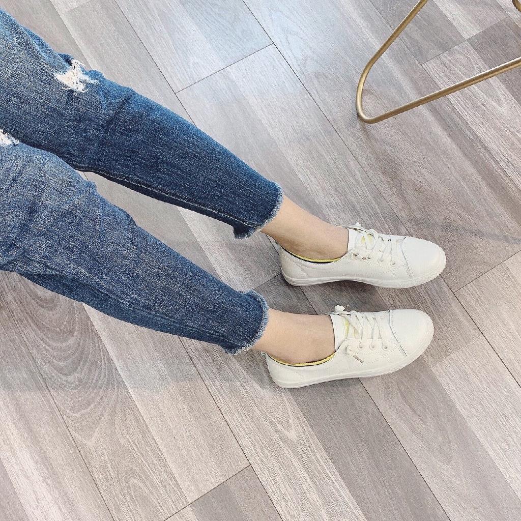 Giày thể thao nữ trắng viền vàng chất da mềm êm