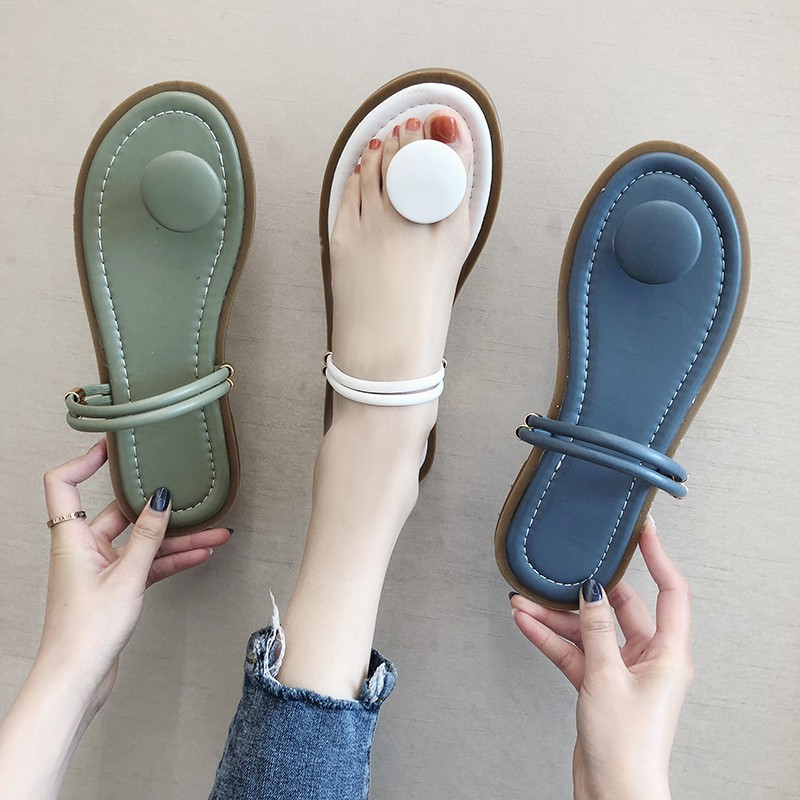 Slippers women wear flat 2019 summer new beach holiday fairy shoes Korean version of the round buckle toe one shoes two