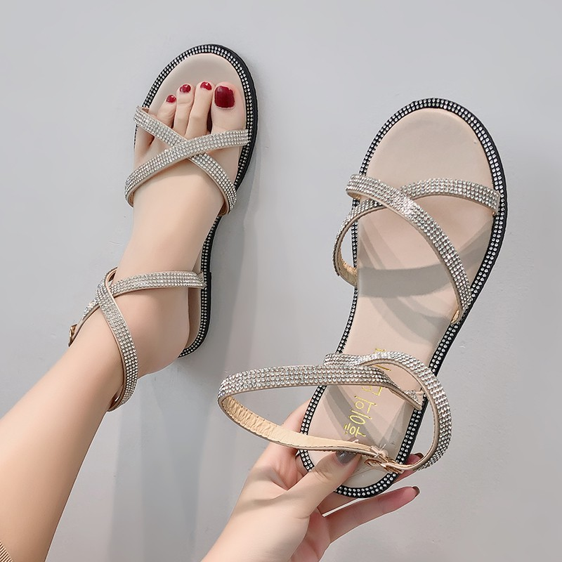 Sandals female Korean version of the open toe rhinestone cross straps fairy wind flat bottom Roman women's shoes