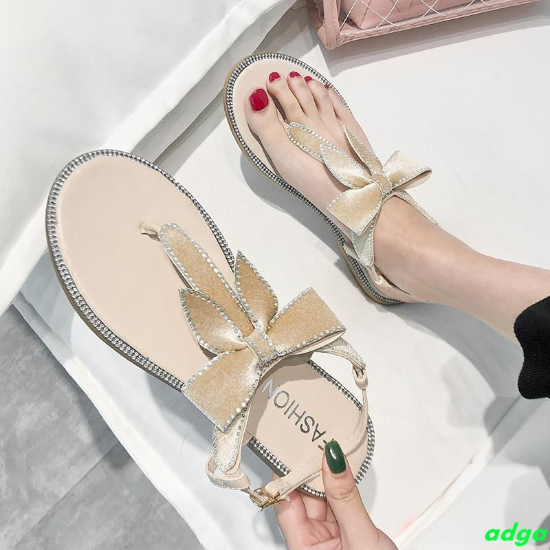 Net red fairy sandals female 2019 summer new wild bow rhinestones toe flat-bottomed word buckle fairy shoes