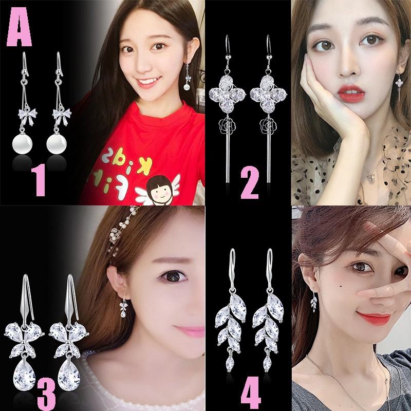 Earrings shaped like long fringed rhinestones