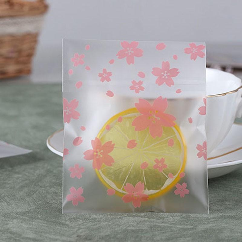 Set 100 túi nhựa đựng bánh quy & kẹo in hình hoa đào có băng dính dán mi