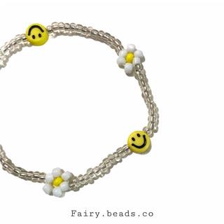 Vòng tay chuỗi hạt mặt cười hình hoa cúc