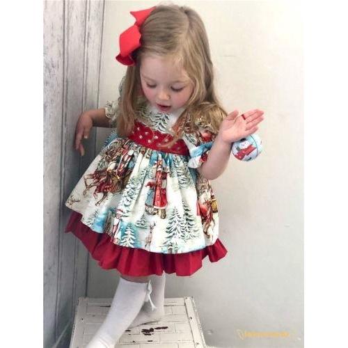 Đầm xoè hoạ tiết giáng sinh cho bé gái