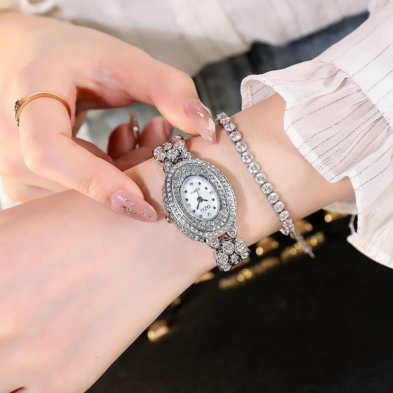 Đồng hồ thời trang nữ DZG D5 mặt oval đính đá dây kim loại siêu đẹp vbc5cv