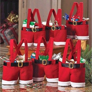 Gift bag containing Christmas style candy for Santa's red pants