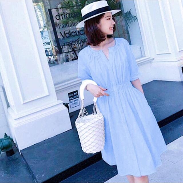 Đầm xanh nhúng eo cổ