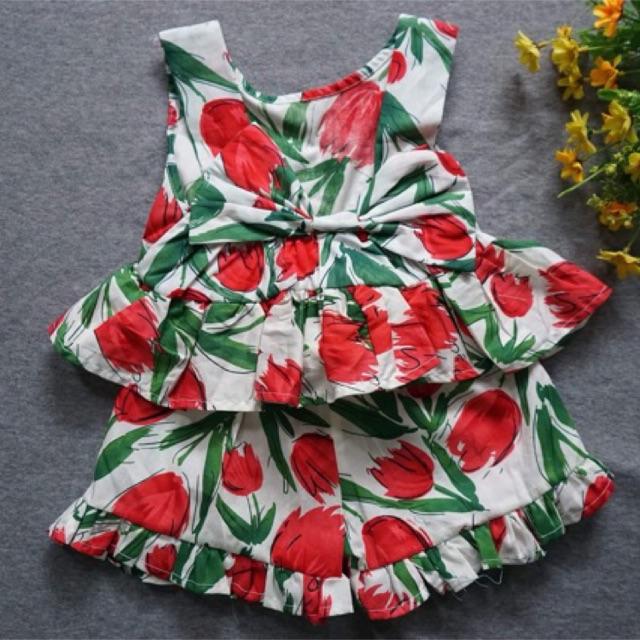 Váy sẻ lưng buộc nơ bé gái