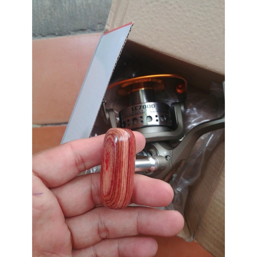 2 máy câu cá yumoshi 7000, cối kim loại, tặng kèm 2 cuộn cước câu 100m