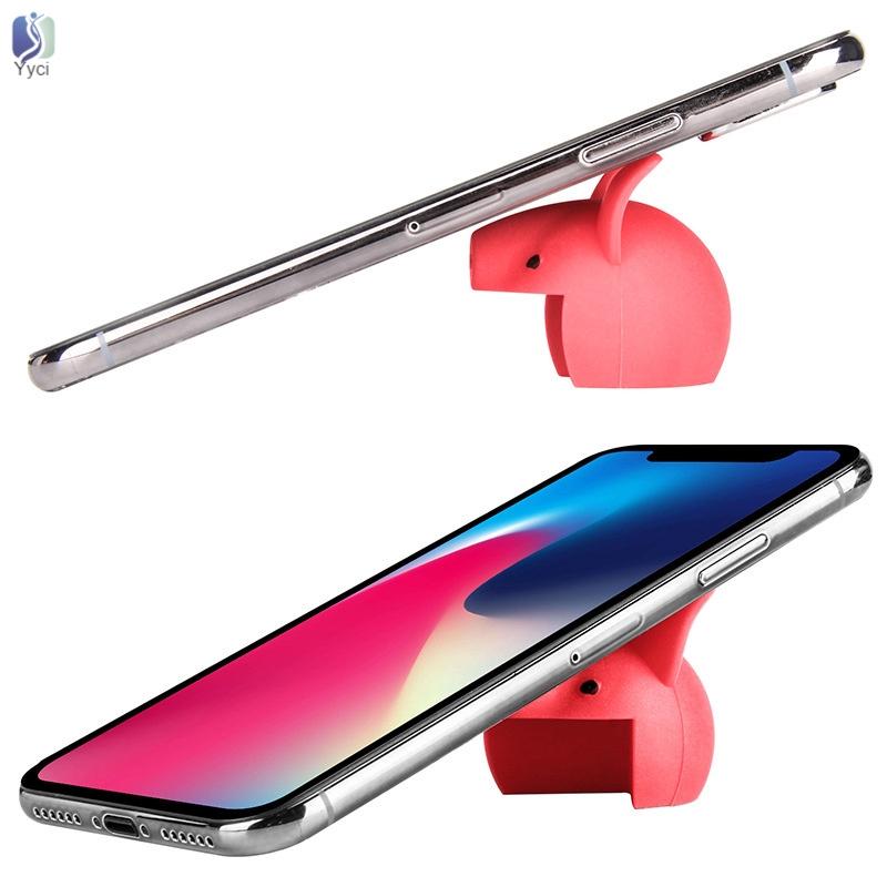Phụ kiện silicon mềm hình hoạt họa gắn cạnh bàn chống va chạm kiêm giá đỡ điện thoại
