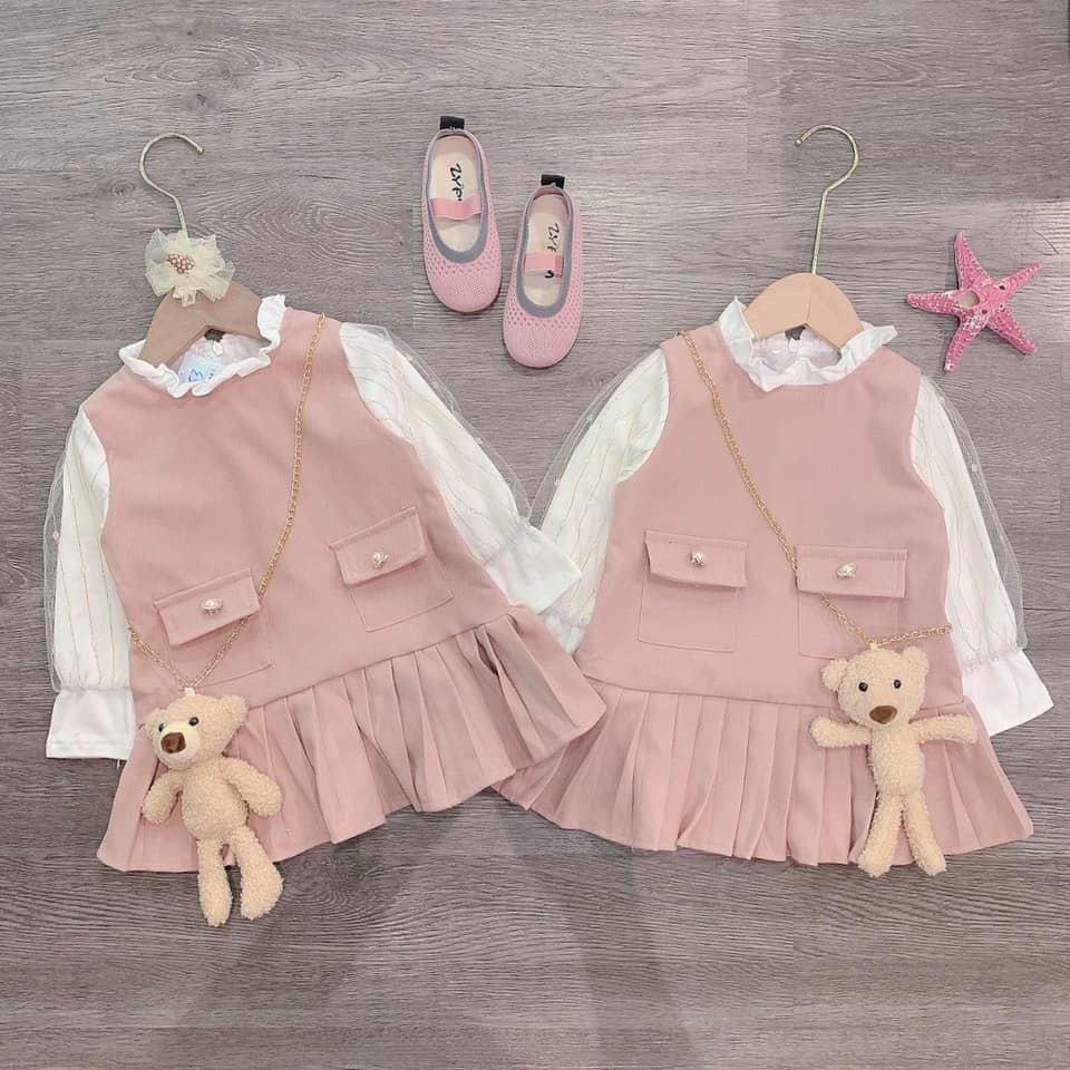 Váy hồng 2 túi chân xếp li bé gái