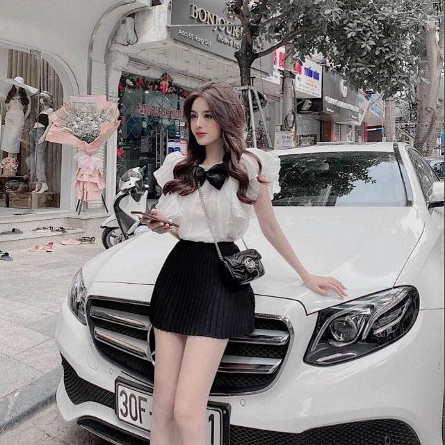 Set nữ áo tay cánh tiên nơ đen mix chân váy có 2 màu trắng, kem SC