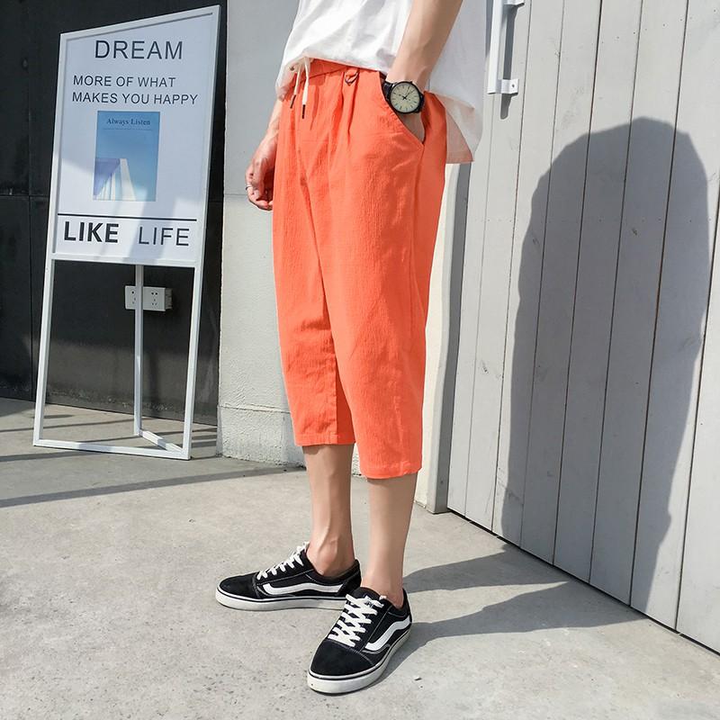 Quần Harem vải lanh ống rộng màu cam cho nam giới